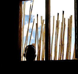 South Sudanese Boy staring inside school and church building, Mercy Partners, Thomas Kilian
