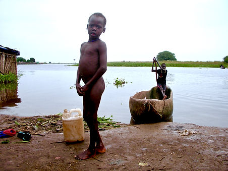 Tom Kilian of Mercy Partners takes photo of youth coming home from fishing in the Nile River, South Sudan, Ethiopia