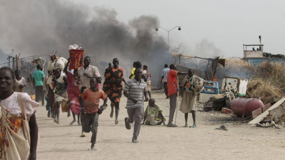 Civilians flee fighting at a United Nations base in South Sudan.