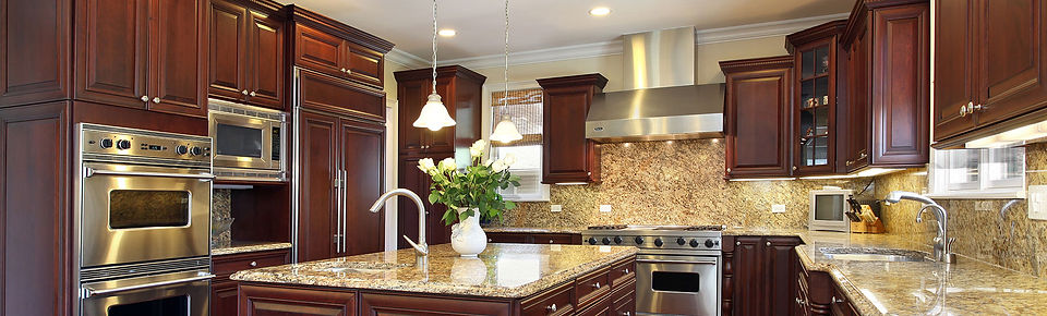 Remodeled kitchen with granite countertops and custom cabinetry