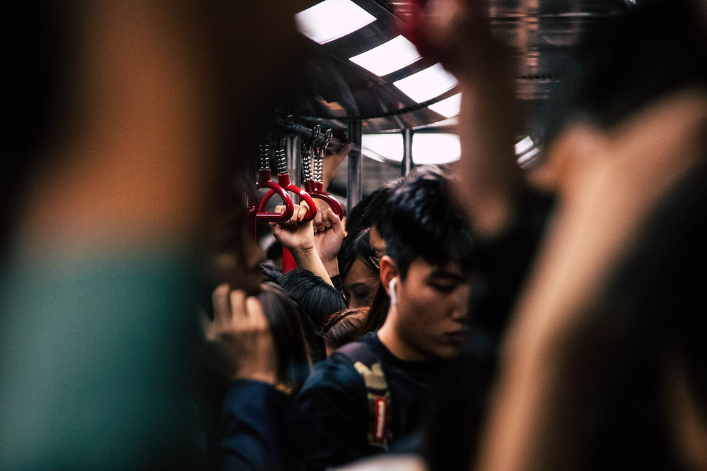 Crowded underground train a mtr train in Hong Kong causing a claustrophobic and depressing state of mind.