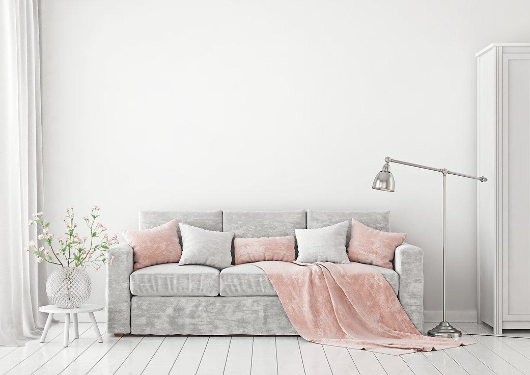 Grey livingroom with grey sofa, pink cushions