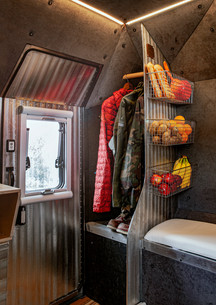 Hanging closet space entry way with storage and divider