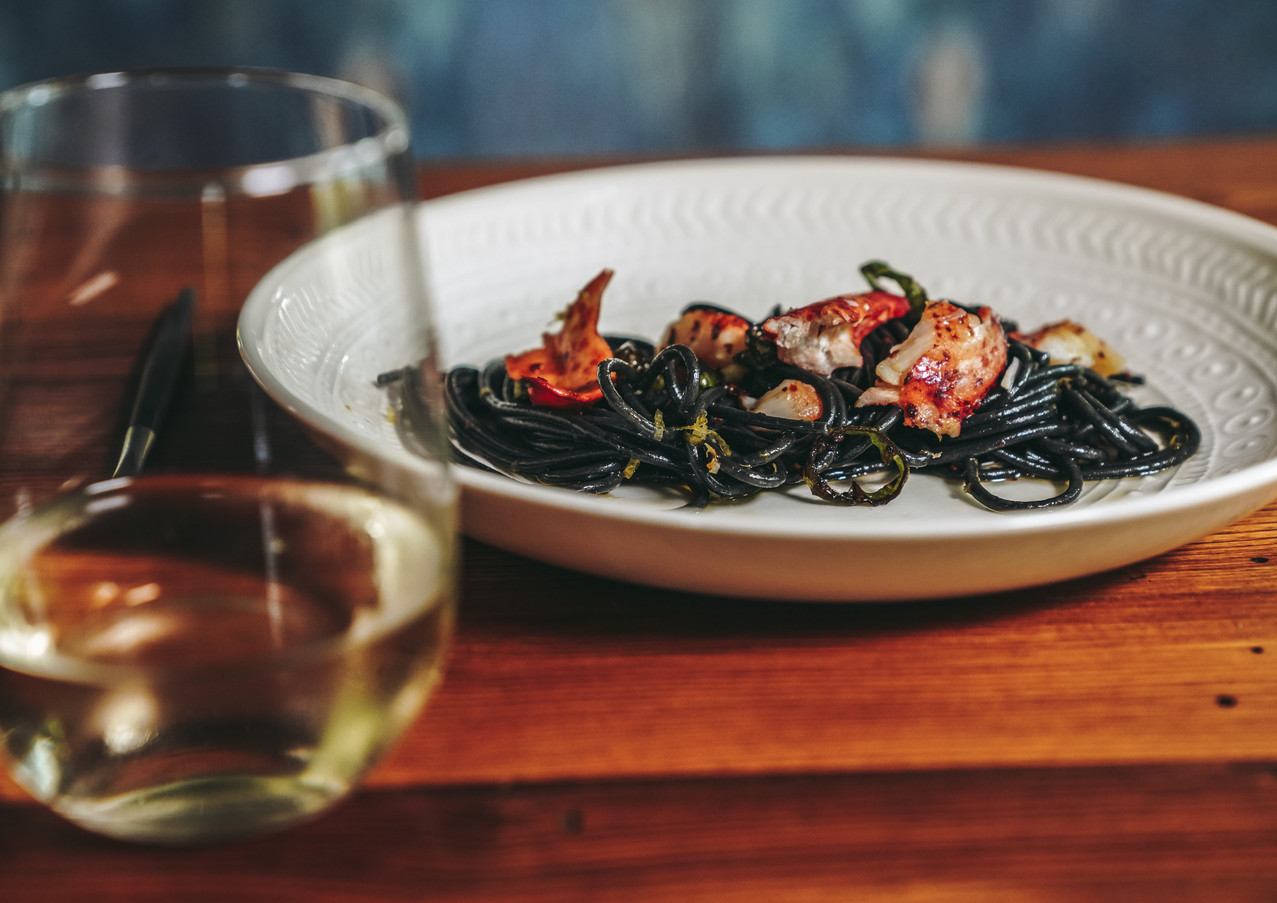 squid ink buccatini | butter poached lobster | fermented long hots