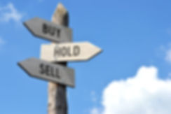 _Buy, hold, sell_ - wooden signpost, clo