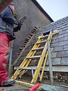 More porch repairs with a man and a ladder