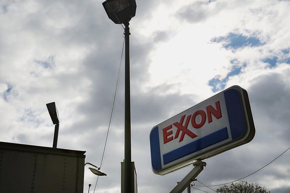 Exxon logo on sign against a cloudy sky