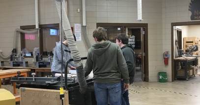 A few 8th graders using the table saw