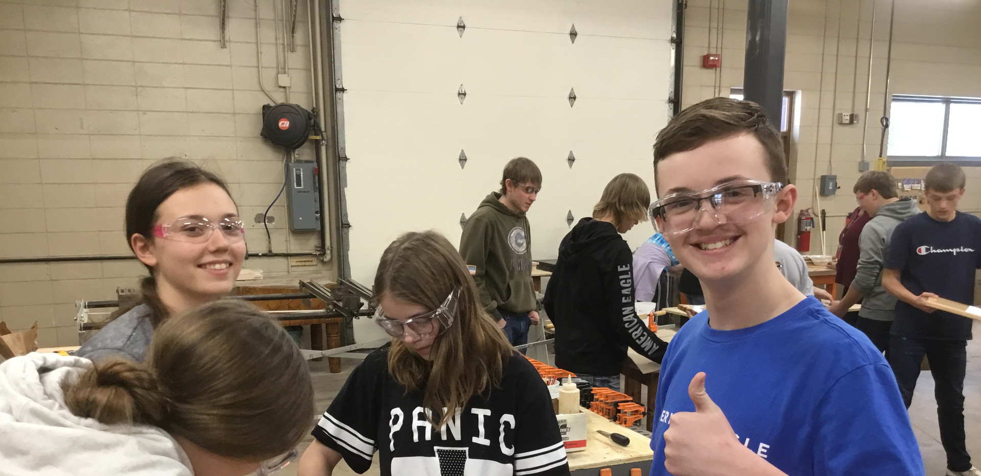 Olivia, Sydney, Greyson, and Serena working on cutting boards