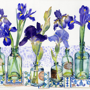 Irises in Vintage Bottles