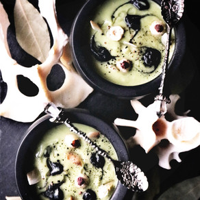 Vegan Sweet Pea + Roasted Romanesco Soup w/ Black Garlic Puree, Hazelnut Eyes + Crisp Parsnips