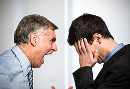 Angry boss shouting to an employee.jpg
