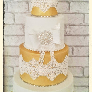 while and gold lace wedding cake