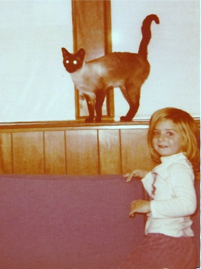 Kougle the cat circa 1973 with my sister Julie