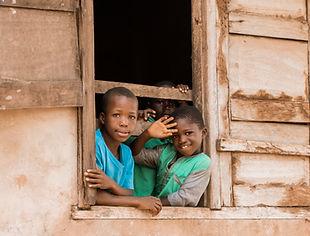 medium-shot-smiley-kids-window.jpg