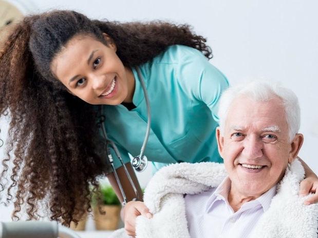 Office-caregiver-covering-elderly-man-1_