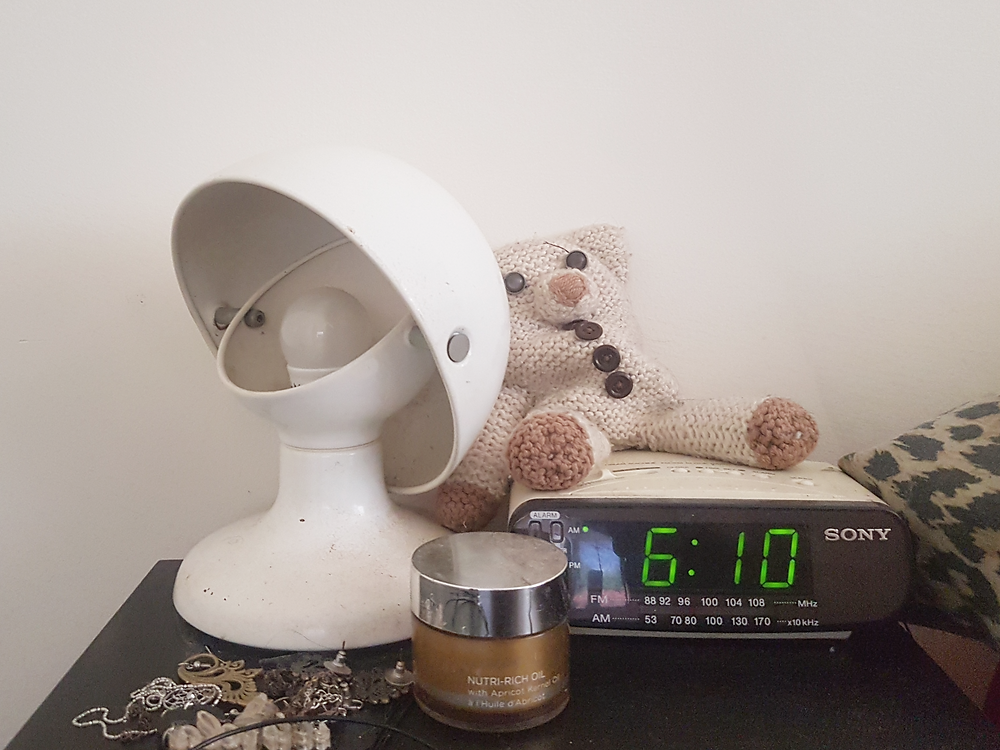 My bedside table, with big old pile of jewellery, teddy bear, vintage lamp, and an alarm clock that says 6.10am, but I actually took this photo at 9.10am Shh don't tell anyone, it's our little secret now.