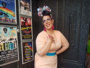 Me at the Lady Velvet Cabaret birthday bash show lookin cute in a peach dress, big pink earrings, and floral head wrap.