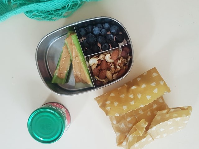 A usual snack pack for me - some celery and peanut butter, a few blueberries, nuts, and a can of tuna, with some corn thins wrapped in a beeswax wrap. A turquoise eco bag peeks into the frame because I am #AESTHETIC