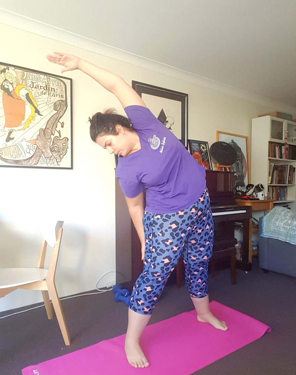 Me doing what at the time felt like an impressive yoga pose but now looking at it, it's not really. But I'm wearing pretty impressive blue leopard print leggings.