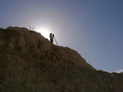 Surveyor at top of a cliff
