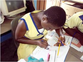Student writing in Ghana