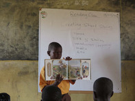 Boy sharing a story with his class