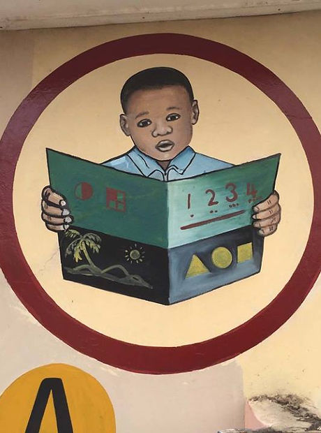 Mural of boy reading a book