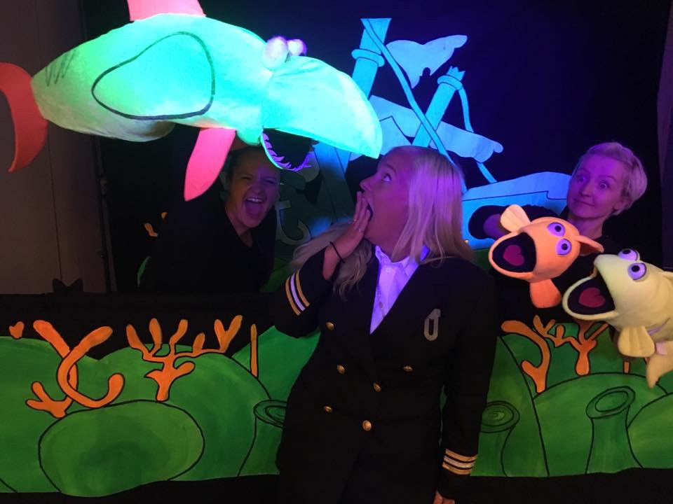 Steph being Steph with a shark and the cruise director Ann-sofie! UV puppets are way too much fun!