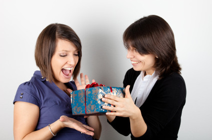 woman giving gift to another woman.jpg