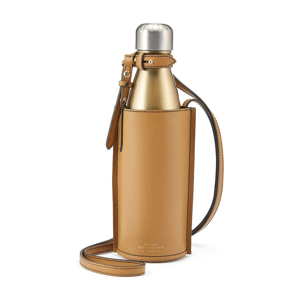 How to go plastic free: carry a reusable water bottle. Smythson x S'Well's bottle set is a fashionable place to start.