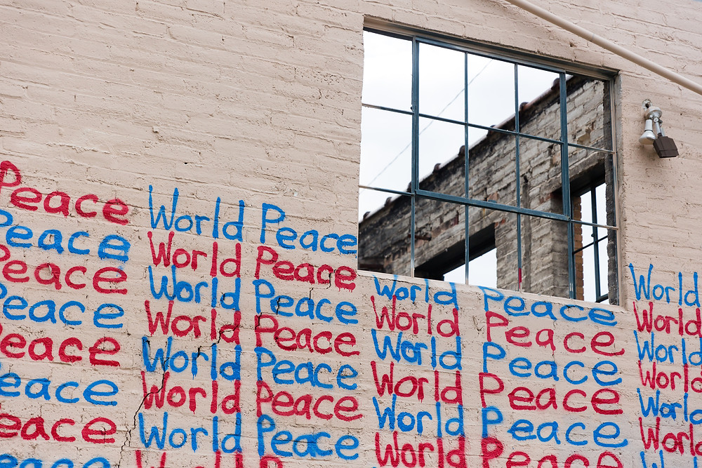 A building with 'world peace' written on it multiple times.