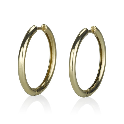 Classic Medium Hoop Earrings , a chic look for everyday. The earrings were made to wear for a lifetime.