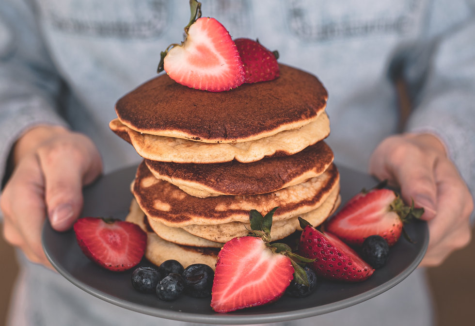 berry stack on plate hands.jpeg
