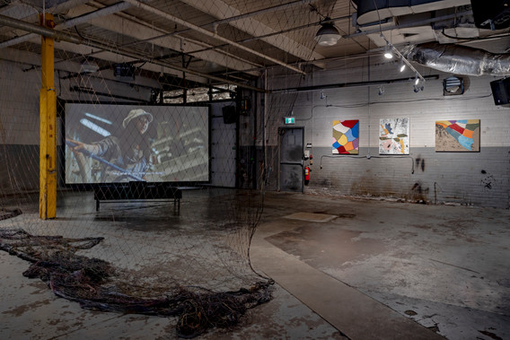 Shezad Dawood, Leviathan: The Cod Trap, 2019, HD video, cod net from Fogo Island, 6 paintings. Co-commissioned by Fogo Island Arts, Museum of Contemporary Art Toronto Canada, A Tale of a Tub (Rotterdam), and the Toronto Biennial of Art. On view at 259 Lake Shore Blvd E as part of the Toronto Biennial of Art (2019). Photo: Toni Hafkenscheid. Courtesy the Toronto Biennial of Art.