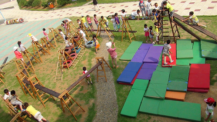 Anji_playground_with_tires,_mats,_and_la