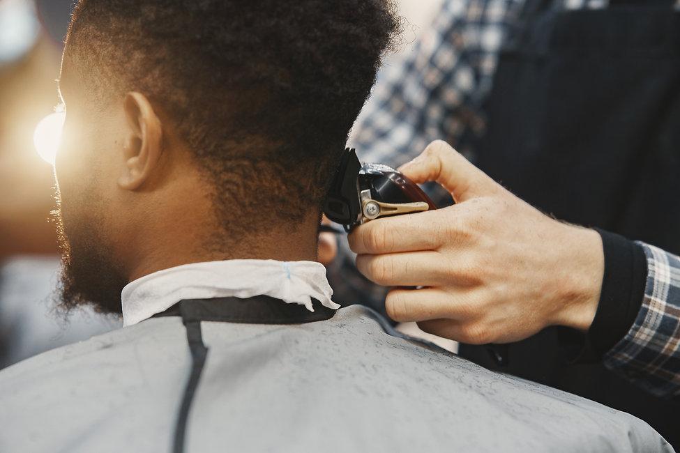 young-african-american-man-visiting-barbershop.jpg