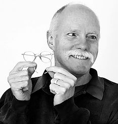Author Ken Brandt holding his very first pair of eyeglasses