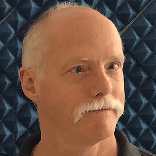 Headshot of author Ken Brandt