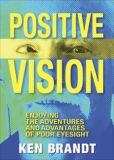 """Book cover of """"Positive Vision: Enjoying the Adventures and Advantages of Poor Eyesight"""" by Ken Brandt. Includes an image of Ken Brandt smiling and with sighly crossed eyes."""