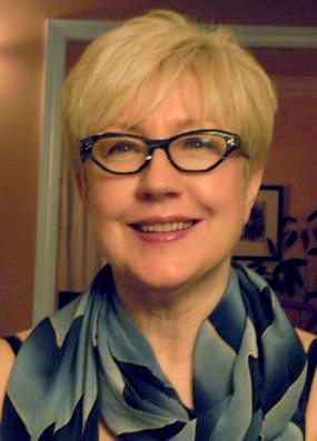 Headshot of editor Elzy Kolb