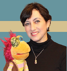 Photo of Viola Kanevsky, OD smiling and holding a muppet. She is the Editor of New York Insights and the author of this book review.