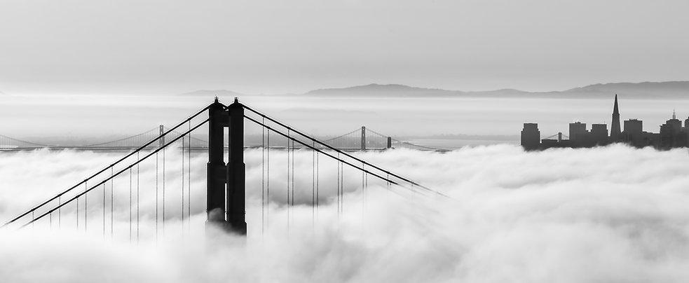Golden Gate Bridge and skyscrapers are