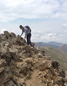 Kathy Russell, Payroll Processor hiking 14er in Colorado