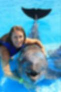 Becky Schweitzer, Accountant swimming with dolphins