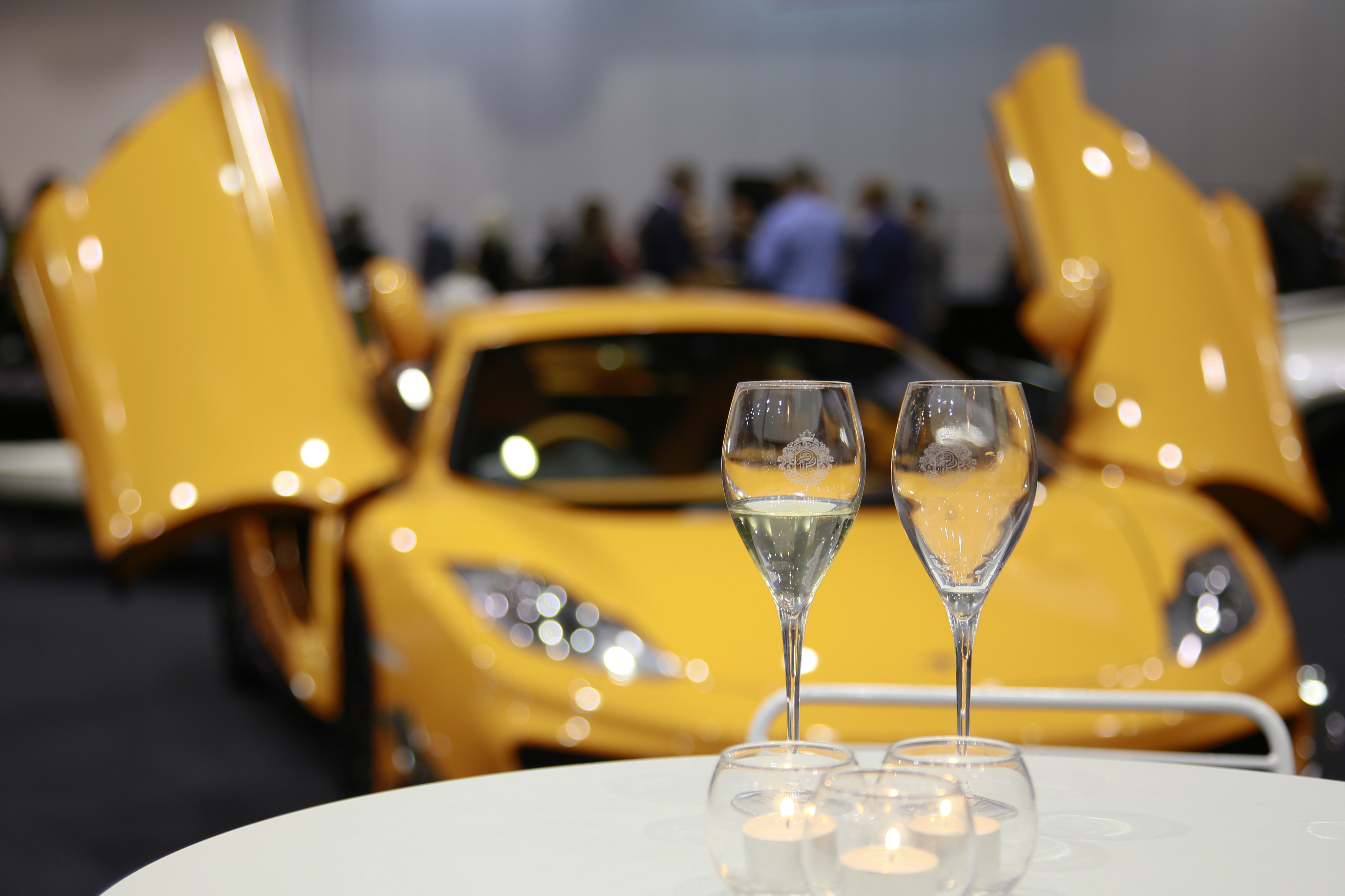 Lamborghini and champagne glasses