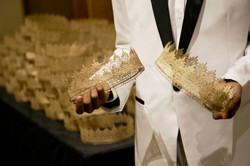 Concierge holding gold crowns
