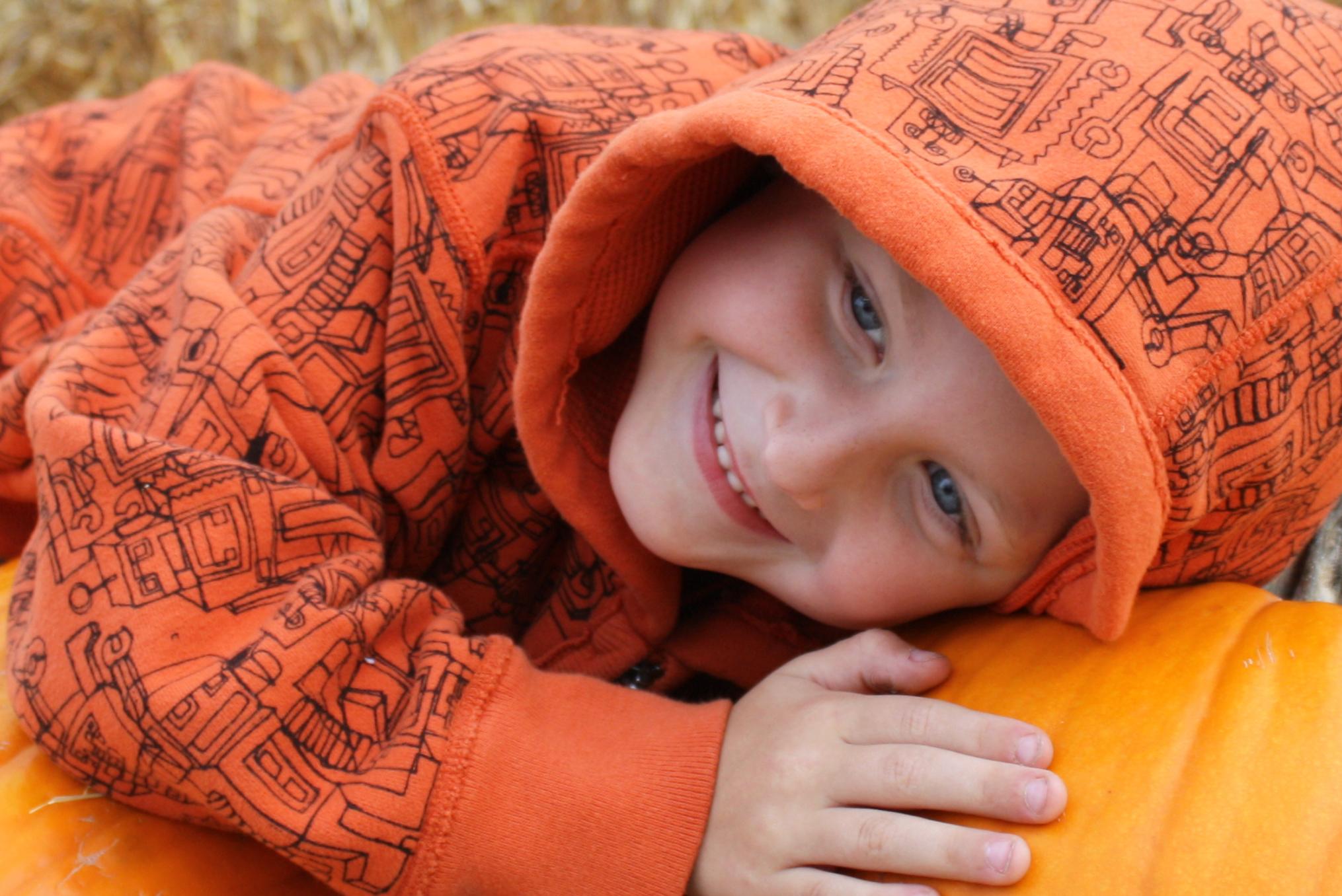 Boy in orange sweatshirt