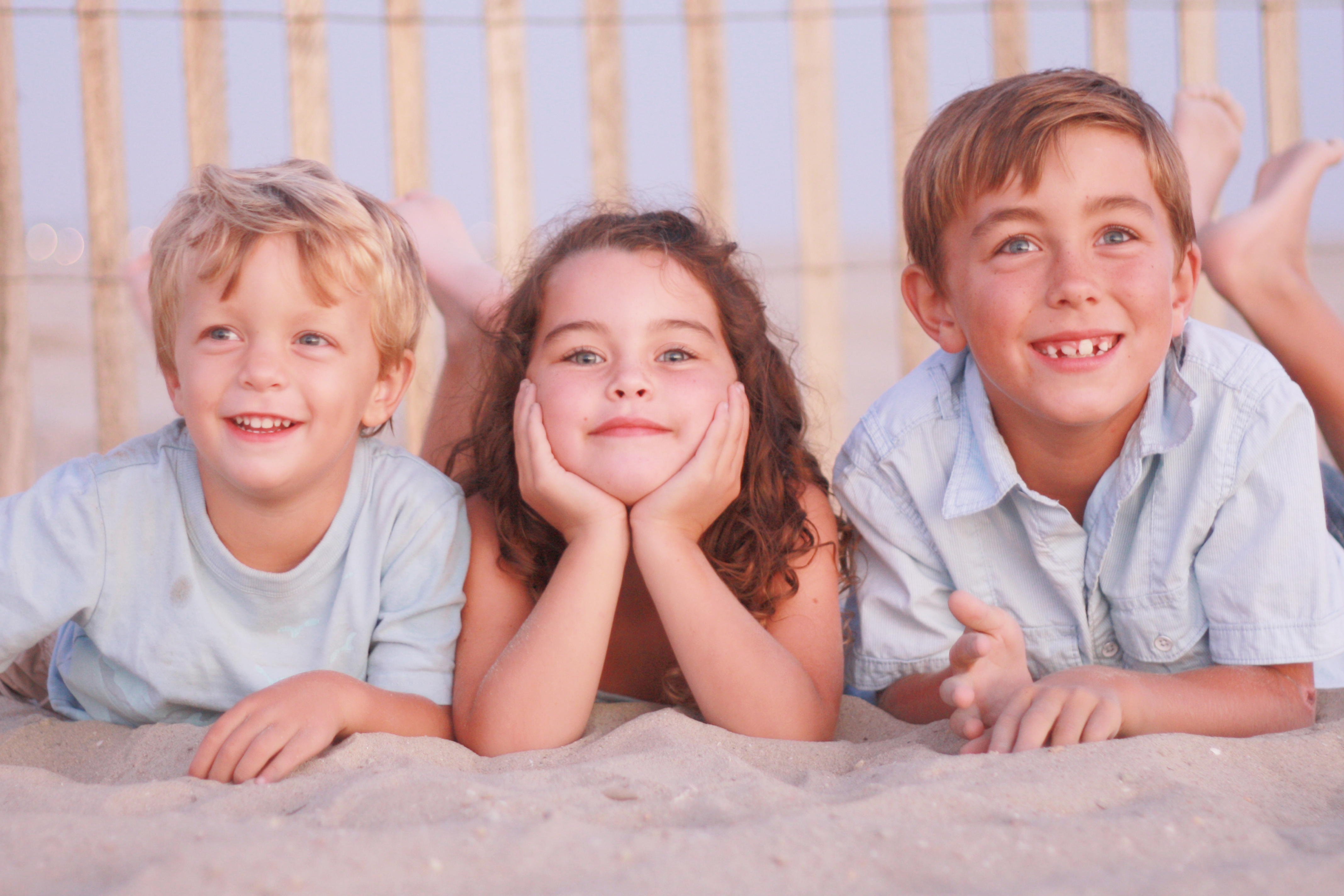 Brothers and sister on beach