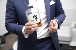 Man and whisky bottle